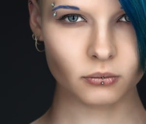 young woman with facial piercings